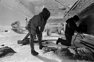 Technicians working at Mount Washington weather station in winter, New Hampshire