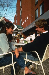 Young couple at outdoor Newbury Street café, Back Bay, Boston