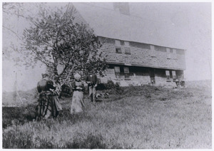 Parson Capen House with people on lawn