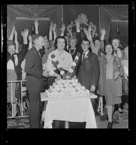 After her overwhelming victory in School Committee fight, Mrs. Louise Day Hicks and husband John, pose with cake at New Boston Club