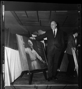 Unidentified man with painting at 37th Annual Exhibition of Paintings by Contemporary New England Artists