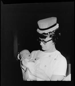 Abandoned baby girl in arms of Nurse Madeline Kaplett at Boston City Hospital where her condition is good