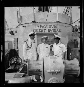 Three crew members on the ship deck of the Italian missile destroyer Impavido