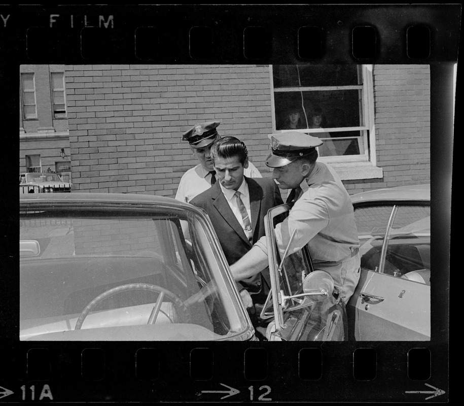 Court officers lead Albert H. DeSalvo of Malden from Middlesex Superior Court after he pleaded innocent to attack charges