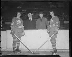 Apps and Drillon of the Maple Leafs with Smythe and Irvin
