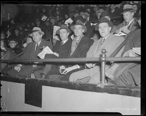 Bruins players sitting in the stands at Boston Garden