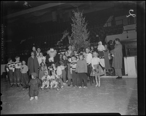 Santa Claus and children at Bruins Christmas party, Boston Garden