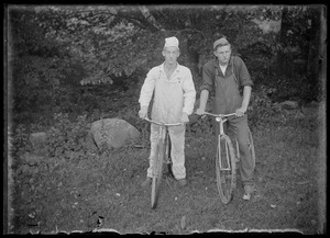 2 young men/bicycles