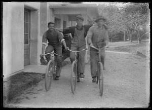 3 young men - bikes. House similar to Seven Gates