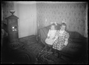 2 children, coal stove in house for ordinary people