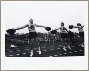 Cheerleaders at football game: Betty Ann Burns, Jean Whitney, Terry Balzer