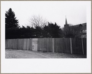 Wooden fence with steeple of St. Agnes Church in background