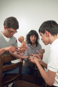 Blind boys feel model of human fetus at Perkins School for the Blind, Watertown
