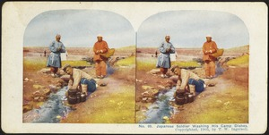 Japanese soldier washing his camp dishes
