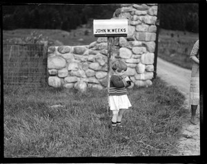 Little girl next to Secretary Weeks mail box at Mt. Prospect in Lancaster, N.H.