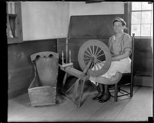 Old woman at spinning wheel at Daniel Webster birthplace, Franklin, N.H.
