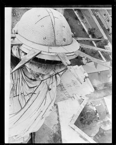 New York steeplejack doing his stuff on top of the Statue of Liberty