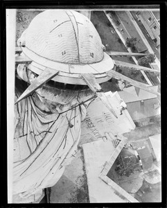 NYC steeplejack on top of Statue of Liberty
