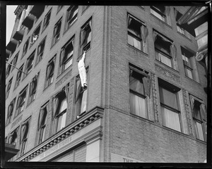 Human fly on building on Tremont St.