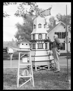 Man painting miniature tower