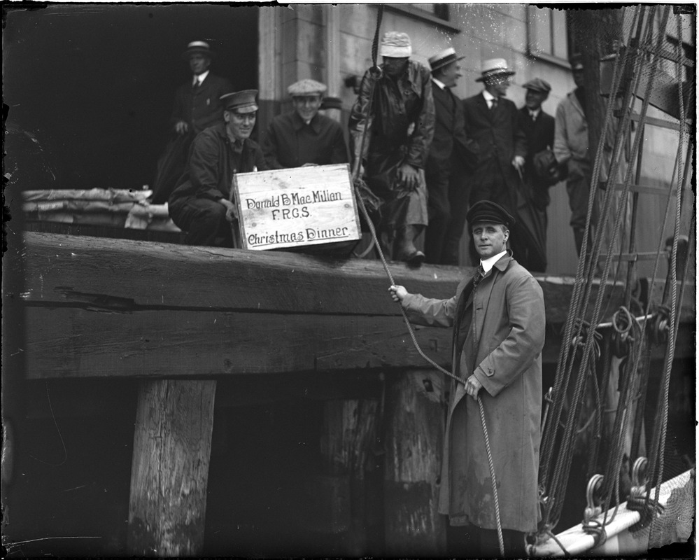 Donald MacMillan loading his Christmas dinner onto the Bowdoin before sailing for the frozen North