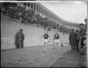 Billy Burke of Harvard beating Tom Campbell of Yale in dual meet at stadium