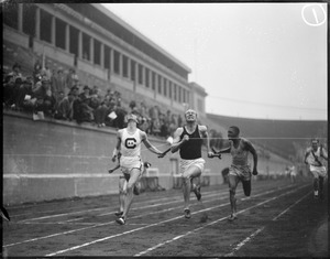 At the finish line during college track meet at Harvard Stadium