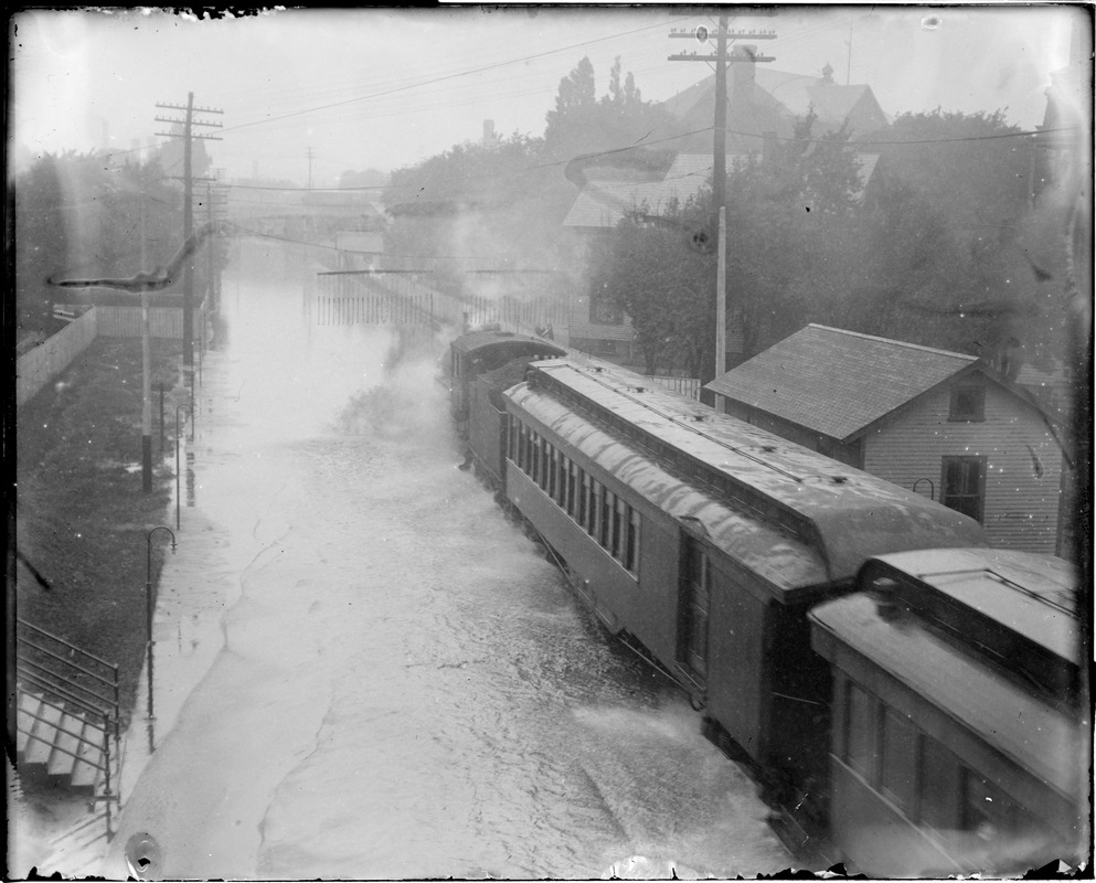 Steam train plows its way through the water after a severe rainfall
