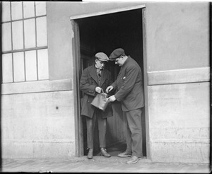 Ammunition factory men have to open their bags before leaving the factory, S.A. Woods Co., South Boston