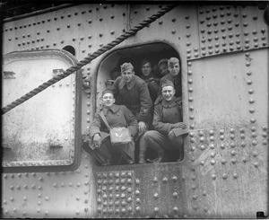 These brave boys found a small hatch in giant troopship so they could sneak out and greet their loved one