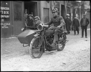 Waterfront guarded from German spies. National Guardsman on motorcycle patrol