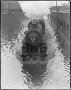 Train plows through water