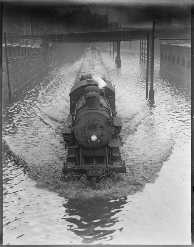 Train plowing through water
