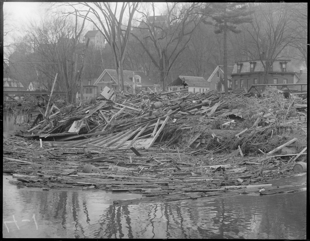Flood wreckage on the Worcester Branch River looking toward Elm Street, Montpelier, Vermont