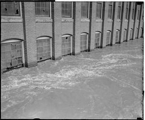 Flood waters reach windows of factory building