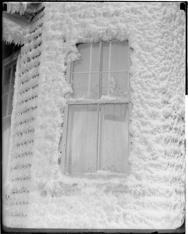 Ice-covered house after storm in Winthrop