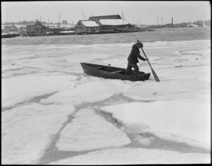 Boat and man in ice water