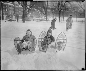 Girls try snow shoes on Boston Common