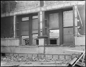 Leaded windows of Adams House dining room during demolition. Was located on Mason St.