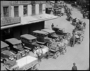 Cars and wagons clutter crowded Quincy Market