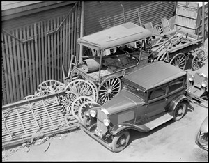 Auto and old wagons in Charlestown