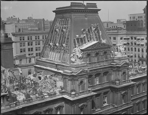 Tearing down old post office from the top