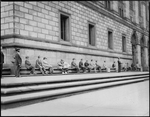 People sitting on Boston Public Library platform