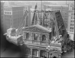 U.S. Post Office being torn down, Boston Mass. Famous old post office building being torn down, showing the last of the two big French's statues being removed.