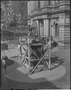 Cleaning a statue, 'old' City Hall Mayor Quincy