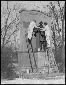 Cleaning the Wendell Phillips statue