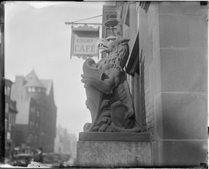 Stone griffin in front of Trinity Court at 175 Dartmouth Street near Back Bay Station
