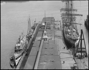 Old T-wharf (incl. large 3-masted square rigged ship on right - the Nereus, King Phillip on left, schooner[?], [illegible])
