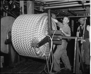"Charlestown Navy Yard/rope making; James J. Lee binding coil of a 7"" Hauser that has just been completed in ropewalk"
