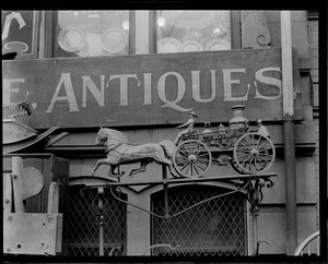 Horse-drawn fire engine advertises antiques